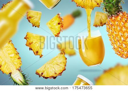 pineapple juice pouried in a glass and pineapple fruits flying around