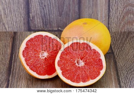 close up from Colorful of grapefruit on wooden background