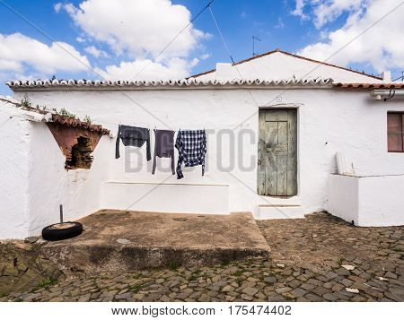 MERTOLA PORTUGAL - MARCH 02 2017: Laundry drying in front of one of the houses in Mertola Alentejo region Portugal.