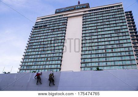 Havana, Cuba on December 22, 2015: Repainting Habana Libre Hotel in the modern neighborhood of El Vedado in Havana, Cuba