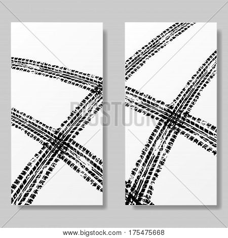 Two white posters with black tire track silhouettes