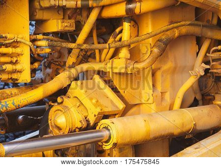motor mechanics yellow excavator tractor engine close-up hydraulic machines