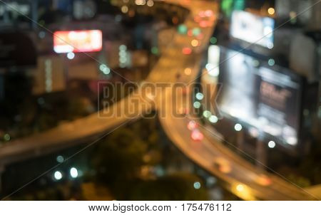bokeh of Bangkok cityscape night view with twilight sky expressway and highway top view Thailand