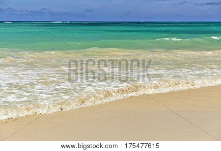 Ocean Surf On A Sandy Beach In Hawaii Closeup