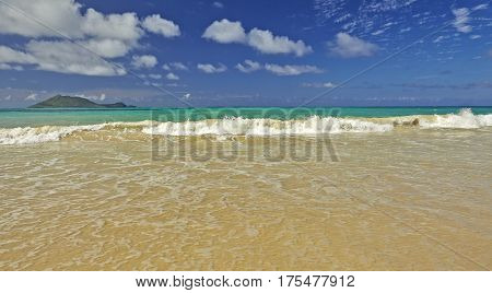 Exotic Tropical Island Sandy Shores And Surf And Sky
