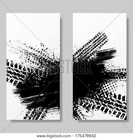 Two white posters with black tire track and ink splash