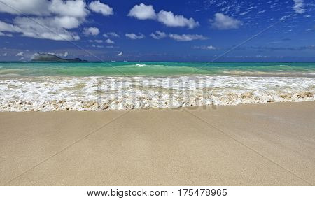 Exotic Tropical Island Sandy Shore And Surf And Sky