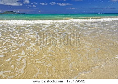 Exotic Tropical Island Sandy Beach And Surf And Sky