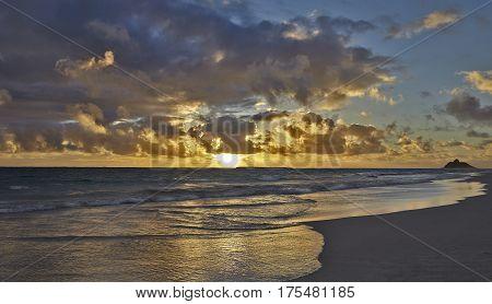 Island sunrise skies on tropical beach and sandy shores