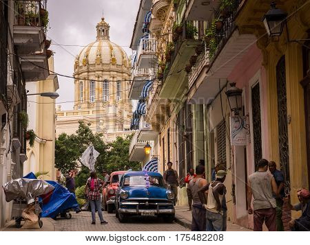 Havana, Cuba on January 14, 2016: Cuban people and oldtimer on street with view on capitol in La Habana