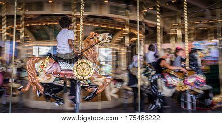 St. Kilda, Melbourne, Australia on Mai 14, 2016: Kid riding on horse on old french carousel