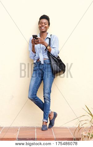 Smiling Black Woman Using Mobile Phone