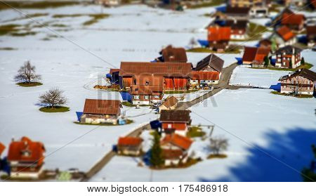Miniature Tilt-shift Aerial View Of The Village In Alps