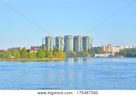 View of Neva river and microdistrict Ribatskoe on the outskirts of St. Petersburg at spring sunny day Russia.