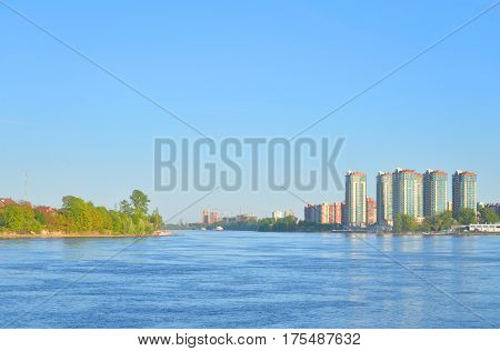View of Neva river and microdistrict Ribatskoe on the outskirts of St. Petersburg at spring sunny day Russia. poster