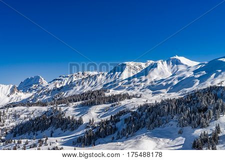 Beautiful Mountains In Snow. Evening Aerial View With Shadows.