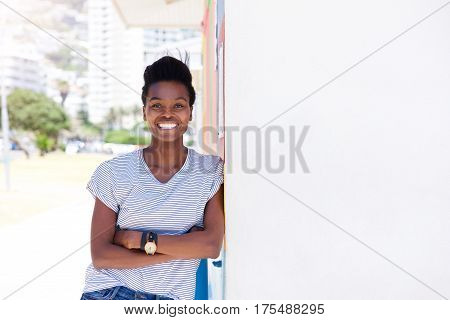 Confident Young Woman Smiling Against Shite Wall