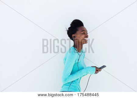 Young Woman Listening To Music Wirth Mobile Phone And Earphones