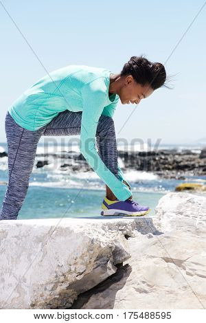 Smiling African American Woman Tying Shoelaces Before Workout