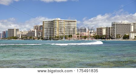Vintage and modern buildings on Waikiki ocean shoreline
