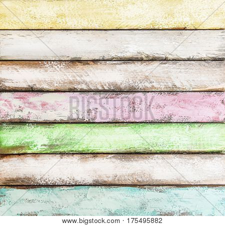 Colorful wooden background. Blue green yellow pink tiles. Vintage wood desk