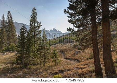 Alpine Mountain Trail - A winding high alpine mountain trail leading to granite mountain in the background on the Pacific Crest Trail.