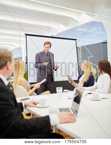 Consultant in a presentation during a business meeting in the conference room