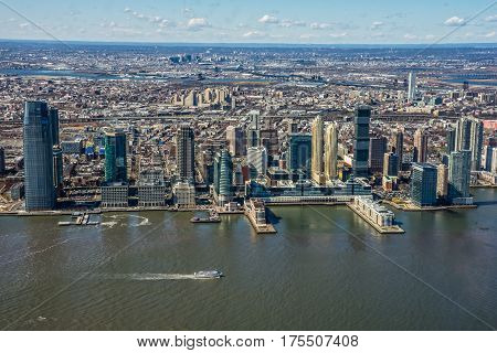 JERSEY CITY NEW JERSEY-MARCH 8 - A scenic view of the Newport section of Jersey City along the Hudson River waterfront as seen on March 8 2017 in New Jersey.