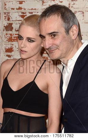 LOS ANGELES - MAR 7:  Kristen Stewart, Olivier Assayas at the