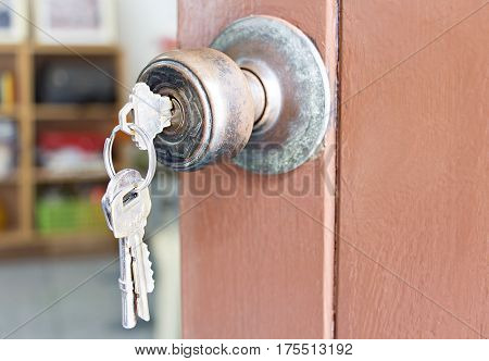 Door knob and keychain on the old wooden door