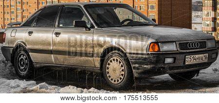 Kazakhstan, Ust-Kamenogorsk, 24 february, 2017:Audi 80 B3, old dirty car, iced