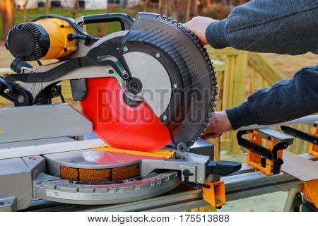 Carpenter Working With A Saw For Flooring