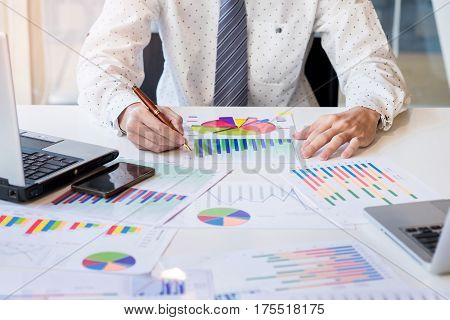 Working Process Startup. Businessman Working At The Wood Table With New Finance Project. Modern Note