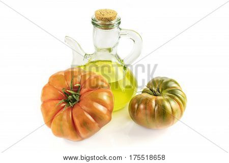 A photo of a shiny bottle of extra virgin olive oil with tomatoes Raf on white background