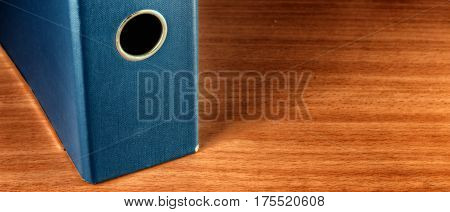 Folder for documents on a wooden background office supplies folder for storing necessary papers