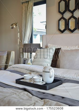 Decorative Tea Cup Set On Black Tray In Modern Bedroom Interior