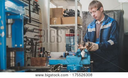 Grinding metal construction in car auto workshop - sparks of circular saw, horizontal