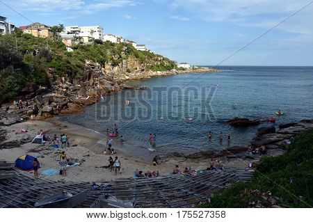 Sydney Australia - Feb 5 2017. People relaxing swimming and sun bathing at Gordon Bay. Located south of Clovelly with the best access from the Clovelly headland car park.