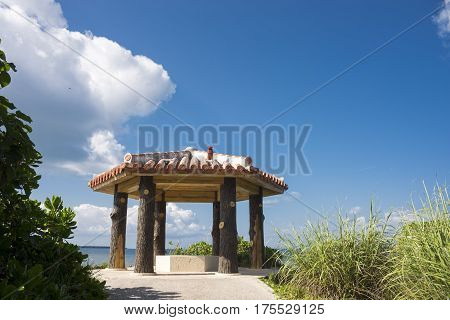 Tiled roof arbour under blue sky in Ishigaki island