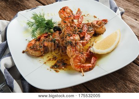 Served table with appetizing japanese food. Tasty fried shrimps with spices, herbs and lemon, top view. Appetizing meal. mediterranean food concept