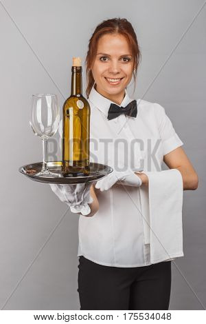 Woman Waitress With A Bottle Of Wine And Wineglass