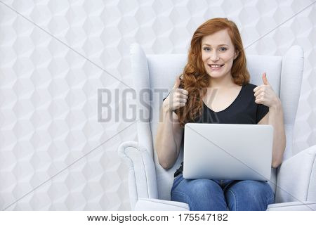 Girl Holding Thumbs Up
