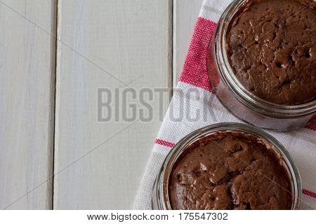 Chocolate Souffle From Above on White Table with Copy Space