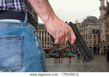 Killer With Gun And Crowd Of People On The Street