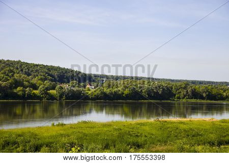 Beautiful landscape with a river and a sandy beach on a summer day. Oka river Russia.
