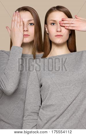 art portrait of young beautiful woman. two girls in one effect