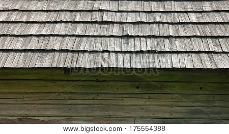 Old wooden house with shingle roof. Old traditional Ukrainian architecture.