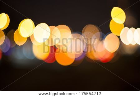 Night road. Blurred lights for abstract color background.