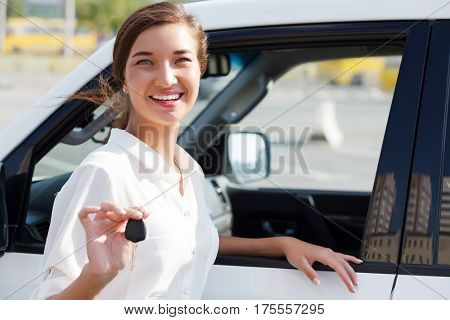 Pretty girl shows a car key