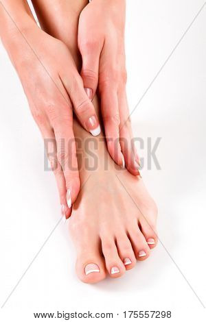 Woman foot and hands, white background